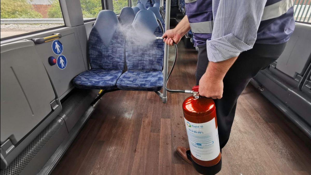 Rapid-10 anti-virus sanitiser being applied on public transport, in this example on a bus
